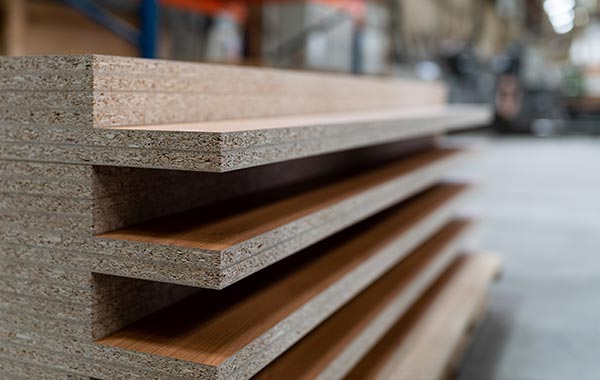 Closeup on wooden shelves stocked in factory