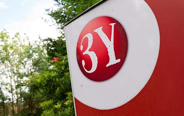 closeup to 3Y logo on signage outside of the building